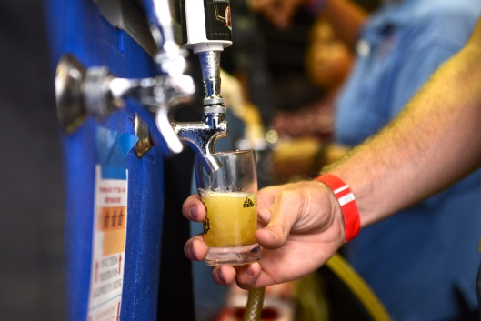 Local breweries serve samples of their beer at the Brew Hee Haw craft beer tasting event during the OC Fair. ///ADDITIONAL INFORMATION: 7/18/16 - ocfair.0720.brew - SHELBY WOLFE, STAFF PHOTOGRAPHER - More than 80 craft beer selections will be available from local brewers like Newport Beach Brewing Co. The 21-and-older event will feature unlimited 2-ounce tastings, music, craft beer education and contests. Sessions are 1-4 p.m. and 6-9 p.m. Saturday, and 2-5 p.m. Sunday